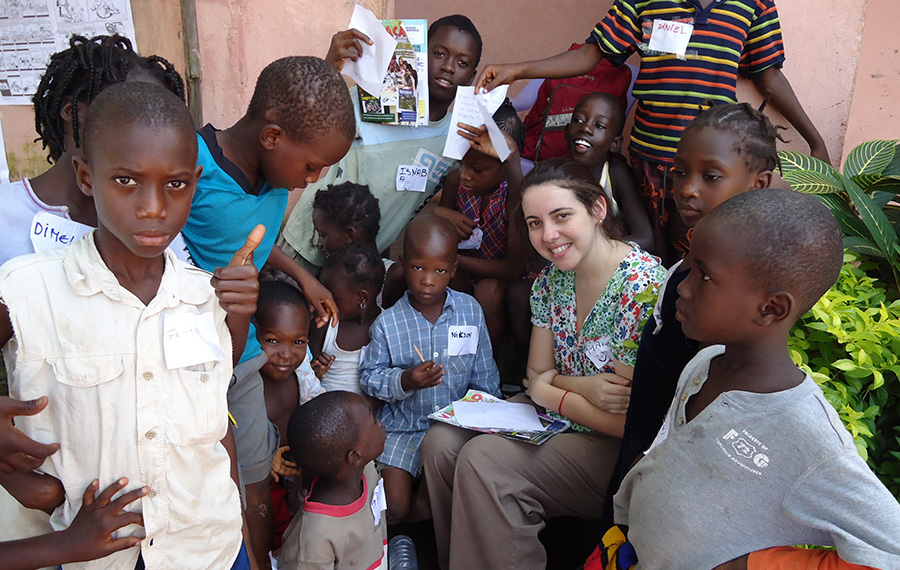 Maria Rehder (centre) is a Brazilian UN Volunteer working as Communications and Advocacy Officer with the United Nations Resident Coordinator Office in Guinea-Bissau. Here she is surrounded by some of the children who participated in the production of the